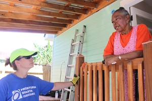 A Presbyterian Disaster Assistance volunteer speaks with Anita Jones as the team puts the finishing touches on Jones' remodeled home.