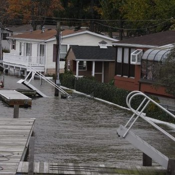 Docks rise in the water on a road in Stony Point on Oct. 29, 2012