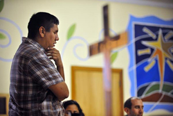 The Rev. Adan Mairena with his hand on his chin, in thought.