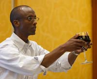 A man holding a cup of wine