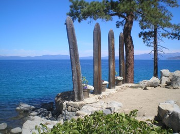 "The ""chancel"" of the outdoor worship space at Zephyr Point features four wooden pillars, representing the four gospels."