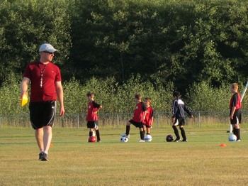 NCD pastor coaches youth soccer team as part of outreach ministry to young, unchurched familes