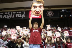 Jack Blankenship holds up a poster of his face.