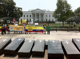A group of people standing in front of the White House for a protest.