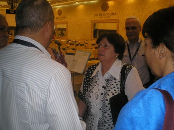 Caridad Diego Vello speaks with delegates after she addressed the 6th Assembly of the Latin American Council of Churches.