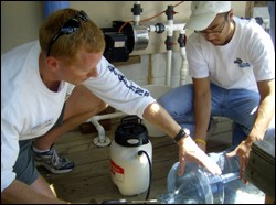 Participants learn about the installation of simple water systems at the May 2009 training session of Clean Water U.