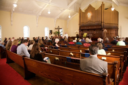 Church members sitting in the sanctuary of First Presbyterian Church in Watervliet, N.Y.