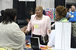 Earline Williams, new chief financial officer for the Presbyterian Mission Agency, visits with Big Tent participants in the exhibit hall.