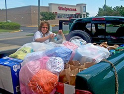 Hunger Action Enabler Jessica Fitzgerald loads her truck with clothing as well as health, food, and baby kits for Eastern Short migrant workers.