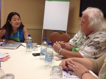 Christine Hong talks with Bill Bess, a workshop participant from Havana, Fla.