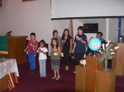 Children singing during a church service.