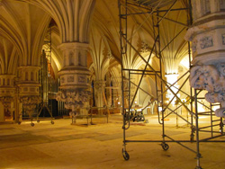 The sanctuary  of First and Franklin Presbyterian Church under construction, in yellow  lighting.