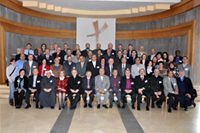 Members of the Fellowship of the Middle East Evangelical Churches grouped together for a photo.