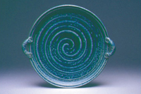 A  turquoise communion ware, with spirical markings