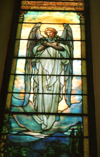 A stained glass image of an angel.