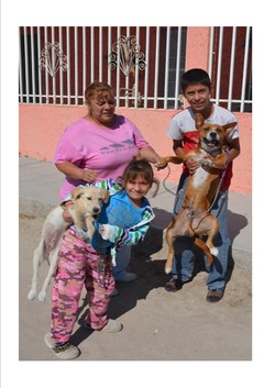Women with their children and dogs in Ciudad Juarez, Mexico