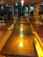 A long wooden table in a room.