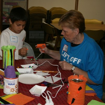Children working on crafts at after school program for unchured kids
