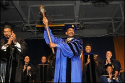 Dr. Ronald Lee Carter accepts the University scepter as a symbol of his installation as president.