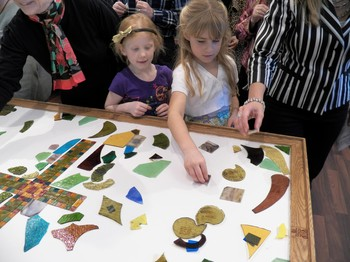 Members collected shards of broken glass from the broken stained glass windows and formed a mosaic tabletop that will be used as the congregation's new communion table.