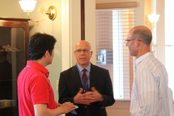 Jim McDonald visits with two SFTS students.