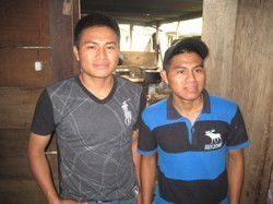Carlos (left) and Jorge in their home outside of Sayaxche, Guatemala.