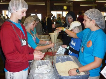 New Covenant youth prepare food for the hungry.