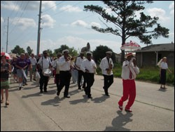 The Treme Brass Band leads volunteers and denomination representatives through the Little Woods neighborhood in New Orleans.