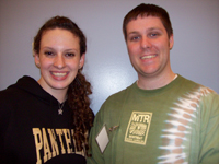 "Photo of a young woman wearing a ""Pathways"" sweatshirt and a man"