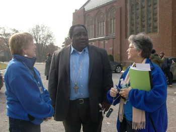 The Rev. Benjamin Patterson (center), pastor of First Presbyterian Church in Far Rockaway, discusses Hurricane Sandy relief needs with PDA National Response Team members Helen Robinson (left) and Donna Melloan (right).