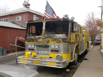A fire engine in Breezy Point, destroyed when flood water shorted out its electrical system and set it ablaze.