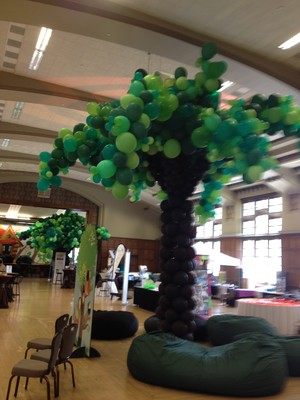 Balloon trees transform the PYT exhibit hall into a treehouse.