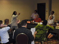 Cynthia White, coordinator of SDOP, led the National Committee in a role-playing exercise.