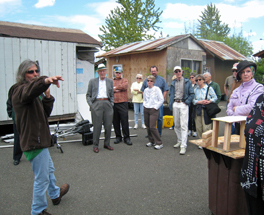 Dignity Village resident Joe Palinkas gives members of Emmanuel Presbyterian Church a tour of the village.