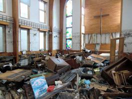 The interior of a church, with things destroyed by an earthquake.