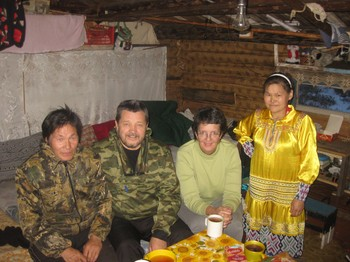"Pastor Vladimir Tashtiev (second from left) and Ellen Smith (second from right) with Pasha (left) and Tamara (right), a Khanti couple near Nizhnevartovsk in Siberia, where one of the PC(USA)'s newest ""twinning"" congregations is located."