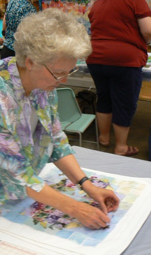 Mary Phillips working on a quilt