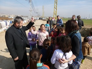 Rev. Fadi Dagher visits with Syrian refugee children