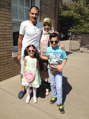 Newly arrived Syrian refugees, Shadi and Hanadi Antakli with daughter Tuqa and son Hasan, at their Louisville home.