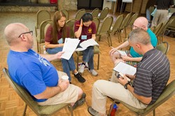 Chaplains gather in small groups to rework previously prepared sermons during the homiletics workshop at the PCCMP retreat at Montreat.