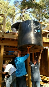 Installing a water collection tank at Clean Water U.