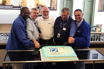 (Left to Right) Alonza Washington, Bob Houser, Rick Turner, Bill Neely and Jim Kirk - original members of the team known as PDAT - cut a cake commemorating the 20th anniversary of the PDA National Response Team.