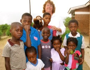 Roberta Updegraff with a group of children in Malawi