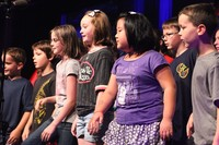 Children sing during worship at Big Tent 2013 in Louisville.