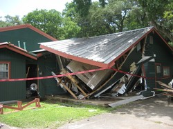 Exterior of the damaged dining hall at John Knox Ranch.