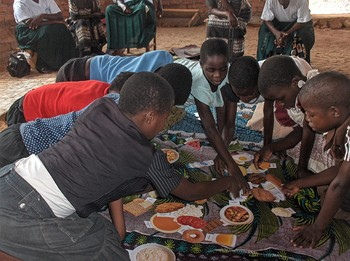 Children in Malawi use food cards to learn about healthy foods.