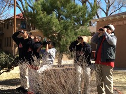 Menaul  6th grade boys on a bird watching expedition on Menaul School campus using  binoculars purchased with John C. Martin Award grand funds.
