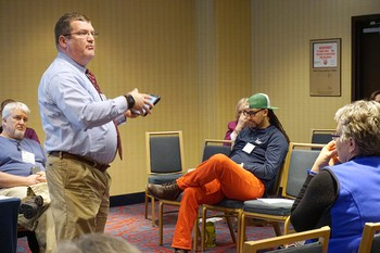 Gordon Mikoski, associate professor of Christian Education at Princeton Theological Seminary, presents at the 2016 APCE meeting in Chicago. Mark Hinds (seated in blue shirt, left) also presented during 'The Confirmation Project' workshop.