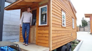 Pastor Mark Zimmerly of Madrona Grace Presbyterian Church in Seattle exits the tiny house being constructed that will reside on church property.