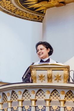The Rev. Najla Kassab of the Evangelical Church of Syria and Lebanon preaches from the Wittenberg pulpit where Martin Luther preached at the onset of the Protestant Reformation.